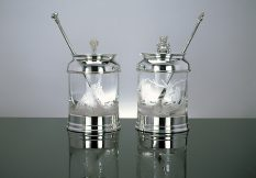 silver and glass preserve jars