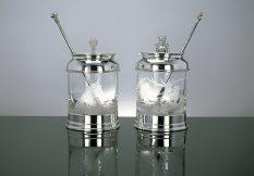 silver and glass preserve jars
